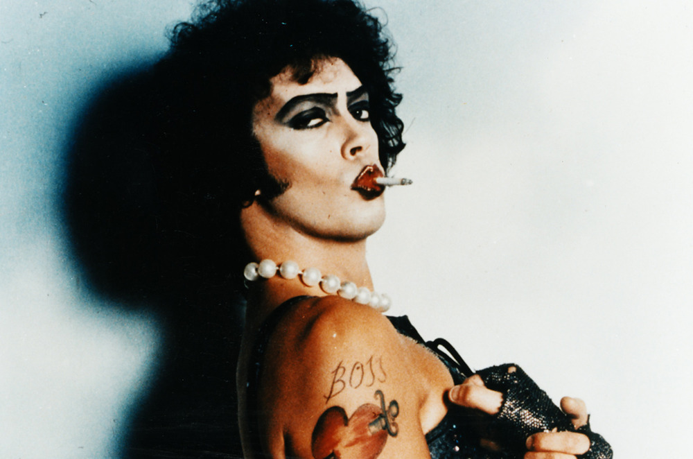 No one does make up for men like Tim Curry